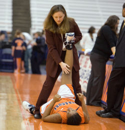 A professional athletic trainer working.